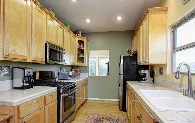 Galley kitchen with recessed lighting