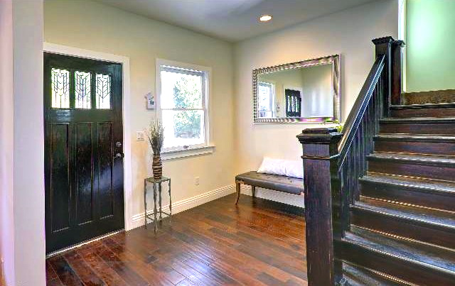 Entry/mud room with mahogany staircase