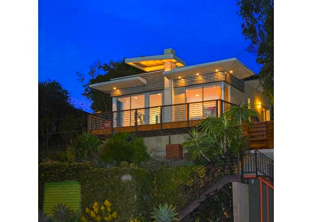 Perched on a knoll with striking looks and views