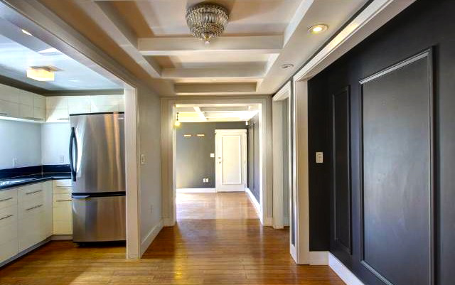 Hallway to bedrooms with moldings and coffered ceiling