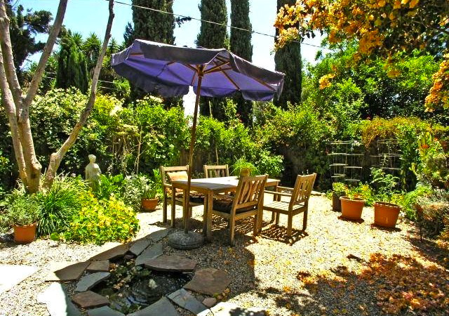 Lush patio. Courtesy of Brian Ades  Sotheby's Int'l Realty