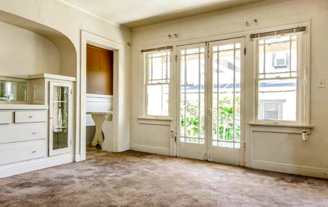 Dining room with vintage sideboard, windows and French doors