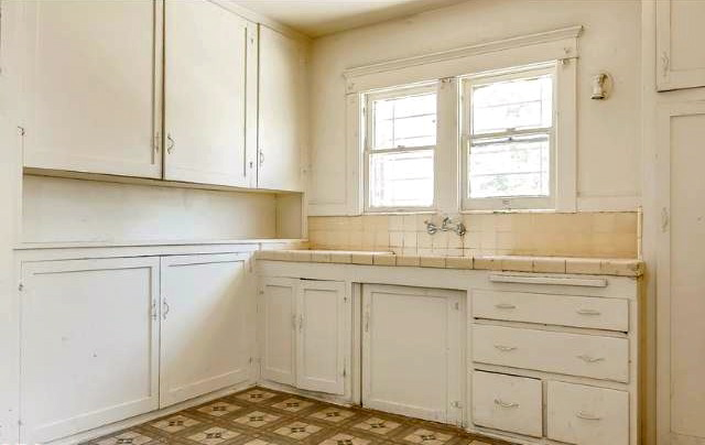 Kitchen with built-in cabinets