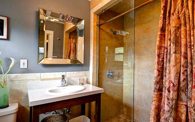 Bath with glass wall