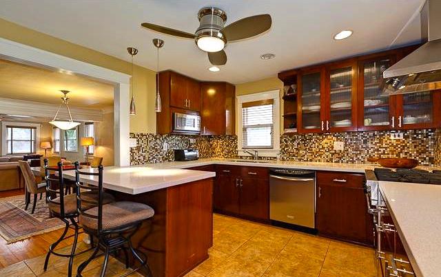 Eat-in kitchen with mosaic tile backsplash
