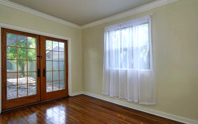 Bedroom with French doors to back yard