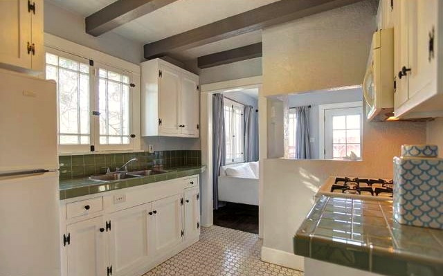 Chateau inspired kitchen with beamed ceilings