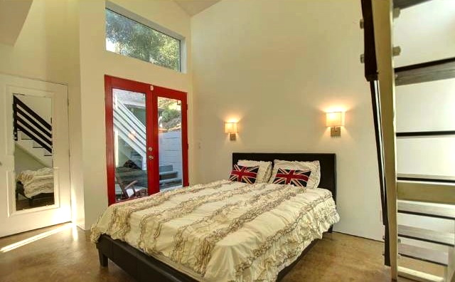 Bedroom with vaulted ceilings