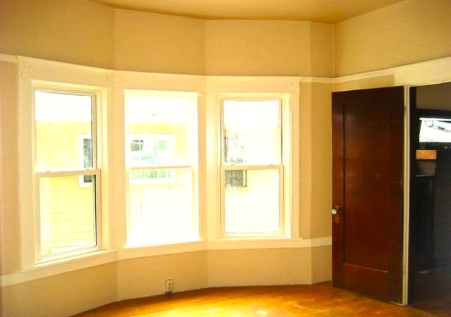 Bedroom with original windows and door