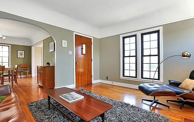 Living room with coved ceilings, archways and original wood floors