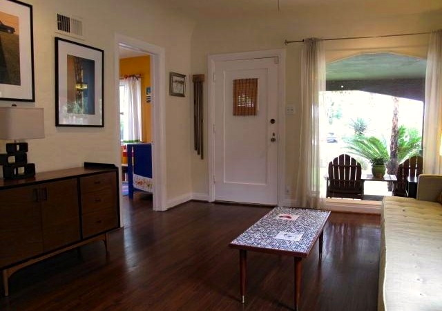 Living room with wood floors, coved ceilings and picture window