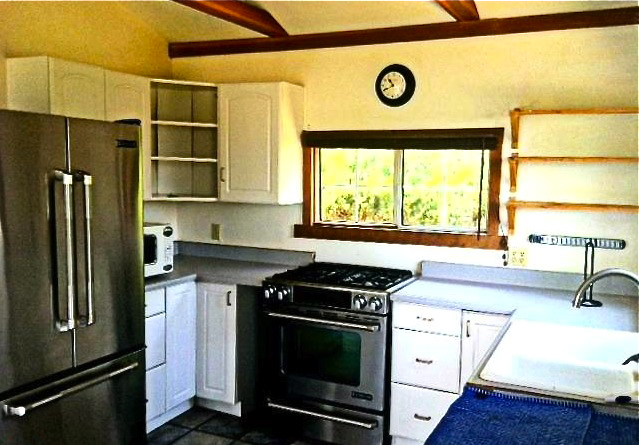 Kitchen with beamed ceiling and professional grade appliances