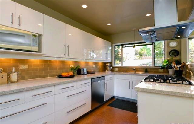 Kitchen with Caesarstone counters and Ann Sacks backsplash