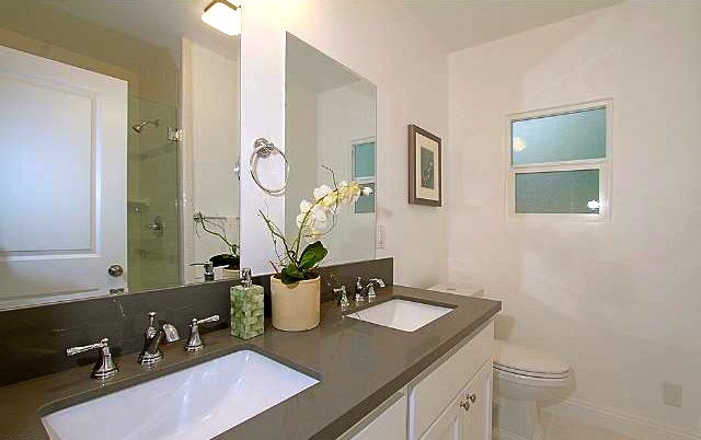 Bedroom with dual sinks