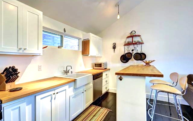 Open eat-in kitchen with butcher block counters