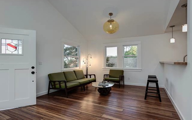 Living room with vaulted ceilings and wood floors