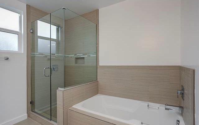 Bath with glass enclosure