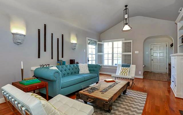 Living room with vaulted ceilings and original windows