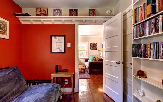 Bedroom with built-ins and vintage doors