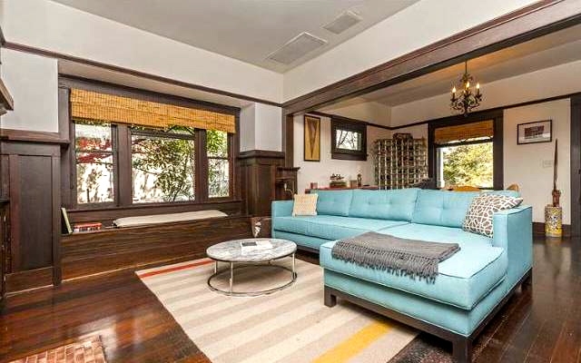 Living room with original wood floors, built-ins and fireplace