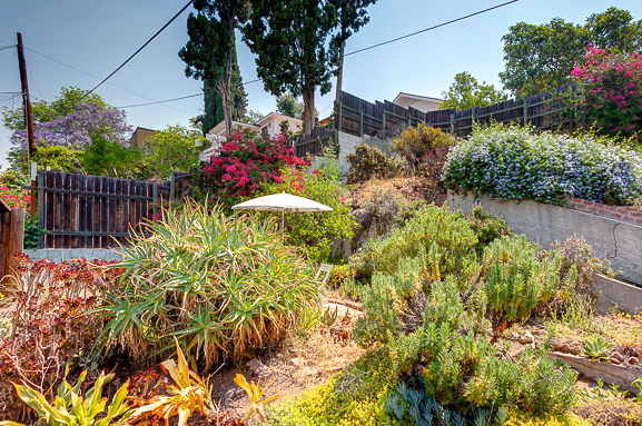 Terraced yard with lush landscaping. Courtesy of Joseph Lightfoot – Sotheby's