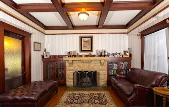 Living room with coffered ceilings, fireplace and built-ins