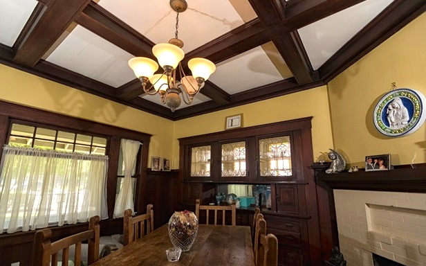Dining room with original leaded-glass sideboard