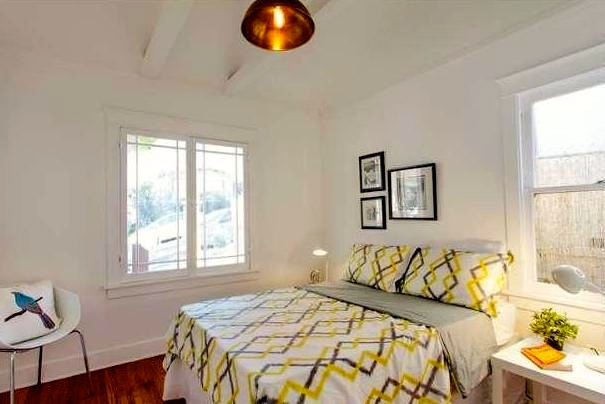 Bedroom with beamed ceiling