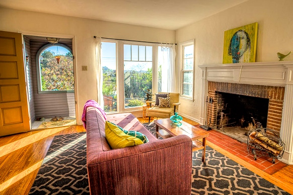 Living room with original wood floors and panoramic views
