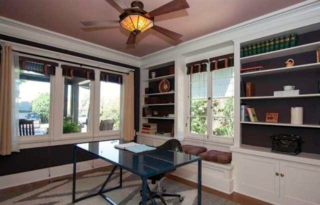 Office with built-in bookcase and window seat