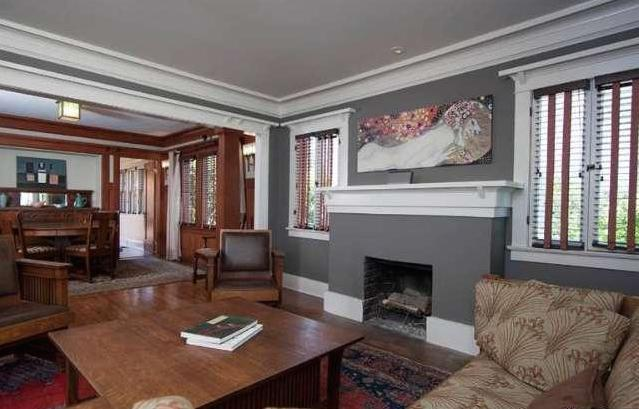 Living room with fireplace and original wood floors
