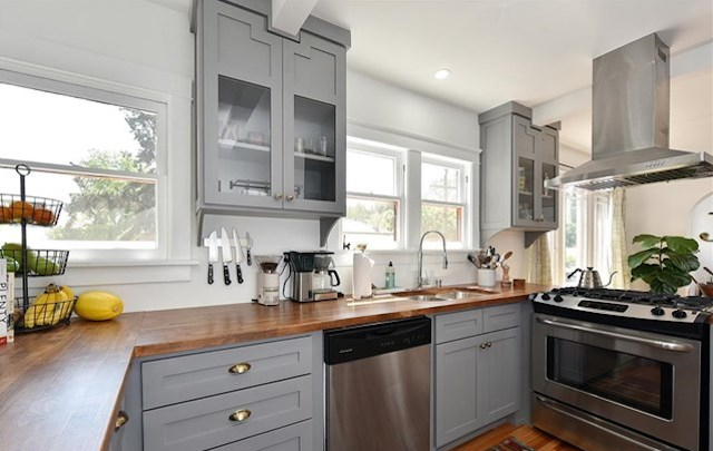 Vintage-y redone kitchen with butcher block counter