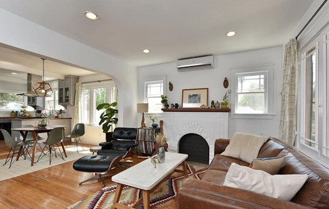Living room with open floor plan and wood floors