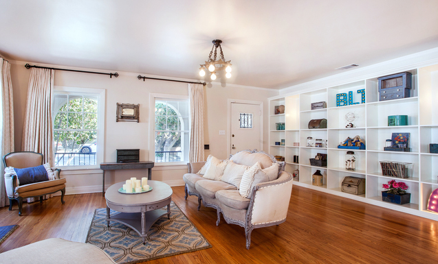 Living room with wood floors and built-ins